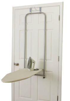 Keep your ironing board on the back of a door, and when you're ready to iron just fold it down and it's ready for use with this over the door ironing board {featured on Home Storage Solutions 101}