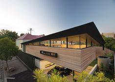 A twisted angular roof oversails this extension to a suburban house in Melbourne
