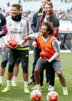 madridistaforever:  Cristiano Ronaldo and Marcelo of Real Madrid react while holding an AFL football during a Real Madrid training session at Melbourne Cricket Ground on July 17, 2015 in Melbourne, Australia.