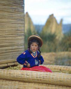 Little girl in reed boat, Lake Titicaca, Peru         by  Jim Zuckerman