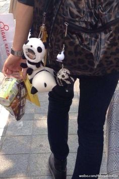 Tao has a Panda plushie bag accessory with his face in it xD This is so cute <3