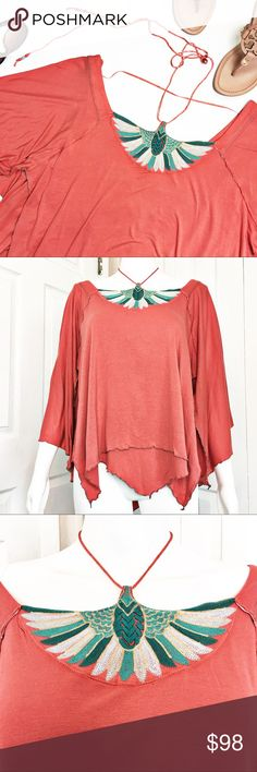 "Free People Mayfair Tee This is the perfect Top to rock at your next upcoming music festival.  Fluttered sleeves and hem with an Embroidered Halter tie.  Coral in color with sea foam green embroidery.  Material tag listed in photos.   Measurements laid flat:  bust:  21"" length from top of shoulder to hem: 25"" *Measurements are approximate. Free People Tops Tees - Short Sleeve"