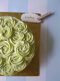 This is a beautiful St. Patrick's Day cake! I really need someone to teach me how to frost cakes.  I really stink at it.