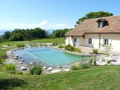 Piscine naturelle en Haute Savoie natural but can someone tell me how to do this in english.it is so beautiful. Swimming Pool Pond, Natural Swimming Ponds, Natural Pond, Swimming Pool Designs, Piscine Diy, Dream Pools, Backyard Retreat, Garden Pool, Cool Pools