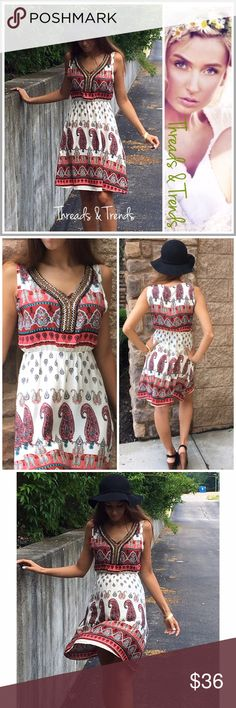 """Paisley Print A Line Dress Stunningly beautiful paisley print A line dress featuring a beaded neck line. A pop of salmon, red, and turquoise perfect for the summer time. 100% viscose. Non see through. S, M, L.                     Small Bust 36"""" Length 35""""  Medium  Bust 38"""" Length 36""""  Large Bust 40"""" Length 36"""" eyelet Dresses"""
