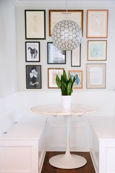Kitchen banquet and tulip table. Geometric light fixture.