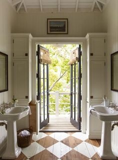 Checker painted floors and french doors in this charming bathroom. That art above the doorway is everything. House Tour: Historic Beauty in Mill Valley - Design Chic. Bad Inspiration, Bathroom Inspiration, Bathroom Pictures, Painted Floors, Beautiful Bathrooms, Cheap Home Decor, Home Decor Accessories, Home Remodeling, Bathroom Remodeling