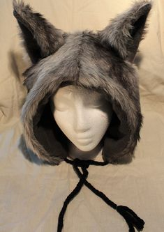 You could use this for a part of a wolf costume  Grey Wolf Hat by Kinderbat on Etsy