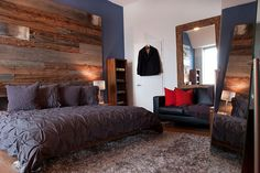 Urbane bedroom with reclaimed wood accent wall and organic bedding in gray - Decoist