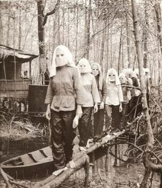 Vietcong women, wearing masks, returning after training [685x800] 1972