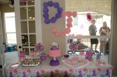 Ribbons & bows 1st birthday party.  Pink and purple birthday.