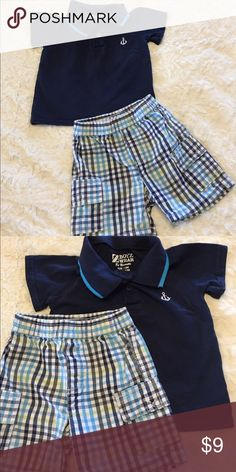 Anchor/plaid short set. Size 12M Boyz Wear by Nannette navy collared shirt with anchor on chest. Matching plaid elastic waist cargo shorts. Excellent condition; no stains or holes. Smoke free/cat free home. Boys Wear by Nannette Matching Sets
