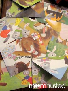 These upcycled children book envelopes are so cute! You could also use wallpaper.