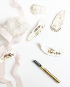 Metallic gold hand-lettering on oyster shells by LH Calligraphy