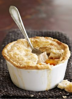 Use up leftover roast chicken in this tasty puff pastry pie with carrot and mushrooms.