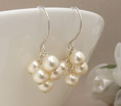 Ivory pearl earrings, silver bridal earrings simple ivory pearl wedding jewelry, pearl cluster earrings. $30.00, via Etsy.