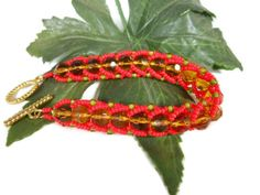 faceted round honey beads, green Rocaille beads and red Miyuki beads