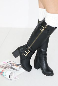 Today's Hot Pick :Buckled and Zip Knee Boots http://fashionstylep.com/SFSELFAA0006079/aurajen/out These leather knee boots with chunky serrated heels, decorative buckle details, and side zip closure are sure to help you create a cutting, razor edge style that will showcase your head on attitude. For a stylish urban style, use with motorcycle jacket, fit tank top, and distressed jeans. For a softer look, pair with an oversized shirt and shorts. - Knee boots - Round toe - Serrated chunky heels…
