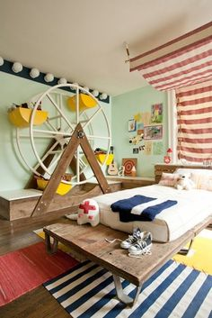 bedroom- I love the hollywood lights at the top of the wall- and the ferris wheel but I would be afraid the kids would try to get in it and break it really quickly and hurt themselves.
