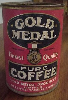 """Gold Medal Pure Coffee tin, 1lb. size.Gold medal products Toronto. Measures 6"""" in height X 4 1/2"""" in diameter."""