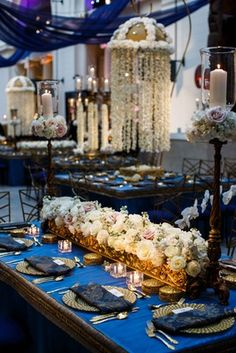 Blue and Gold Reception Tablescape    Photography: bobbi+mike   Read More:  http://www.insideweddings.com/weddings/multi-day-pakistani-wedding-celebration-featuring-bright-colors/796/