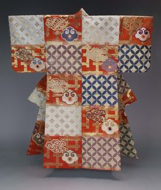 Noh theater robe (atsuita), for male role, with alternating blocks of color (dangawari) in reddish-orange and natural ecru ikat-dyed (kasuri) twill-weave ground with alternating patterns of The Seven Treasures (shippô-tsunagi) and clouds (kumo) with Chinese gongs (chôban) on a gold interlocking key design in blue, green, purple and white silk discontinuous supplementary patterning wefts; purple plain-weave silklining.