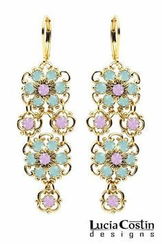 14K Yellow Gold Plated over .925 Sterling Silver Multi Flower Chandelier Earrings Designed by Lucia Costin with Twisted Lines and Dots, Accented with Mint Blue and Lilac Swarovski Crystals; Handmade in USA Lucia Costin. $99.00. Decorated with pacific opal and light amethyst Swarovski crystals. Floral design accompanied by cute details. Update your everyday style with inspiration when wearing this piece of jewelry. Unique jewelry handmade in USA. Floral earrings amazingl...