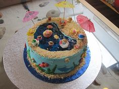 Nothing says summer like a swimming pool and a pool party. I carved a pool in a three layer chocolate cake and filled it with blue jello. Add crumbs, teddy grahams and umbrellas! Cute!