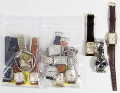 Lot 517: Wrist Watch Assortment; Fourteen pieces including five 14k gold filled, six 10k gold filled and three others with examples from Elgin, Hamilton, Gruen, Longines, Helbros, Bulova and Benrus