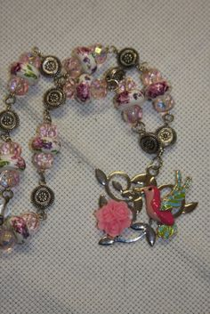 Sentimental journey challenge. Summer memories hummingbird glass pink beads by hudathotjewelry, $25.00