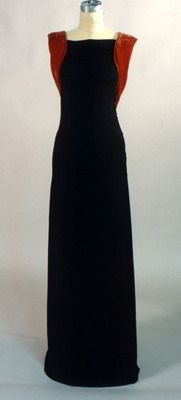 """Evening Dress, Madeleine Vionnet: ca. 1933, bias-cut rayon jersey, silk crepe sash. """"The dress was made of rayon jersey, treated in bias cut to fit around the body. The surrounding sash has the effect of highlighting the sleek body. The dress is from Madeleine Vionnet's personal wardrobe. Front"""