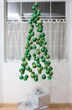 DIY Christmas Tree Ornament Mobile by notmartha: A tree of ornaments floats over the ground.  #Christmas_Tree #DIY #notmartha