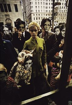 British fashion model Twiggy, surrounded by Twiggy masks, New York City, New York, 1967, photograph by Melvin Sokolsky.