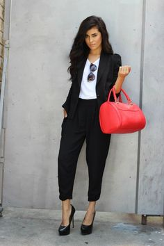 Black harem cut pants paired with a matching blazer and white blouse update the pant suit for a modern, fashionable look