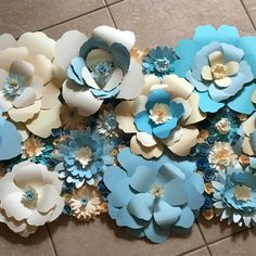 Custom design from this listing.  5 feet of beautiful, blue flowers as a photo backdrop for a baby shower.  So excited to see how this looks at the shower.