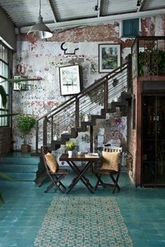 Turquoise teal floors and white washed brick walls
