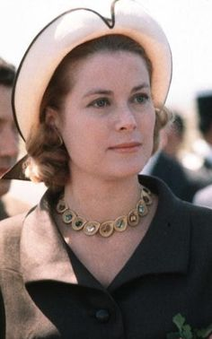 Grace Kelly. Very beautiful when she is looking in this picture.