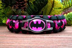 Batgirl Paracord Bracelet in Black and Neon Pink Custom Handmade-Wrist Measurement REQUIED Please Read Listing Details. $16.50, via Etsy.