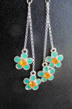 Silver flowers on silver hook earrings from Crimeajewel