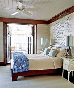 Beach house bedroom with hanging glass stone headboard decor.