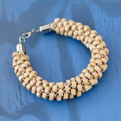 Tan #Kumihimo bracelet - learn more about this technique on #cousin