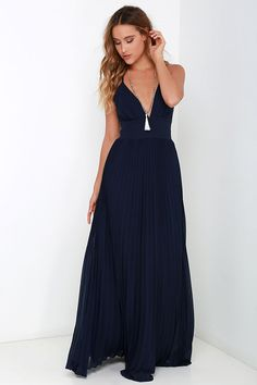 Deeper than the deep blue sea and the Grand Canyon combined ... that's how deep our love for the Depths of My Love Navy Blue Maxi Dress is! Elegant chiffon in a lovely navy blue hue shapes a triangle bodice and sultry V neckline supported by crisscrossing, adjustable spaghetti straps. The fitted, pintucked waistline accentuates your figure before flowing into an accordion pleated maxi skirt. Hidden back zipper and clasp.