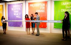 Dr. Katie Rodan, Dr. Kathy Fields and Chairman Amnon Rodan cutting the ribbon for the grand opening at 60 Spear.