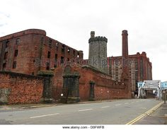 Bascule bridge with Tobacco warehouse and Stanley Dock on Dock Road in Liverpool… Liverpool Waterfront, Liverpool Home, Warehouses, Monument Valley, Past, Buildings, Bridge, Industrial, Stock Photos