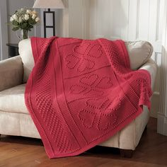 Give your love with this warm richly textured crochet blanket. Shown in (624) Dark Coral, no longer available.