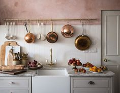 grey and pink kitchen with copper accents by jersey ice cream co | via coco kelley