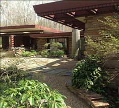 The Dudley Spencer House (1956), Frank Lloyd Wright-designed structure in Delaware. This house is of the hemicycle design, and is built of irregularly coursed fieldstone. This single story house has a flat roof with curvilinear extensions and windows under roof extensions.