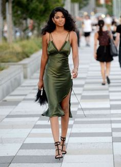 Wheretoget - Chanel Iman wearing a khaki slip midi dress with side split, black high- heeled sandals and a black furry clutch bag