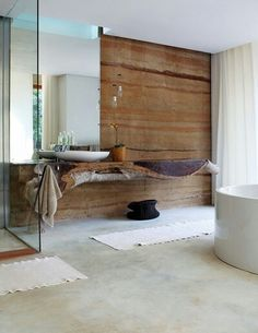 Stone wall and unusual timber vanity are all about texture in bathroom