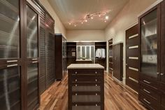 Dress up the hidden spaces in your home with this walk-in closet. By Closet Factory.